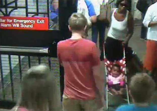 Screenshot of video footage from New York City Police Department on July 8 appears to show Frankea Dabbs, 20, entering the station with her child in a stroller.